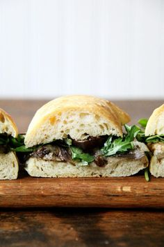 Last week when a dear friend sent me the recipe for Ruth Reichl's balsamic-roasted eggplant and arugula sandwiches, I immediately bought a baguette and set to work slicing, brushing, and roasting the various purple globes collecting on my counter. The result — an unfussy, completely delicious sandwich — sent me racing back to the store,...