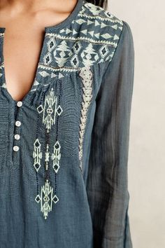 Cotton gauze tunic in indigo blue with ivory embroidery, notch neckline and mother-of-pearl buttons.
