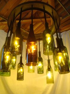 Want this too!!! Wine Bottle Chandelier Up-cycled from Wine Barrel Rings and Used Wine Bottles