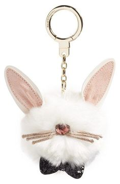 Kate Spade faux-fur charm featuring cute bunny ears and a shimmering nose and whiskers.