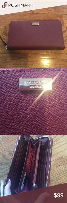 "NWT kate spade wallet!!!! Authentic! A dark red ""newbury lane"". Super cute color.. It's very ""in"" this year! Different, yet trendy. It is very spacious, yet still compact. Perfect as a gift or even better for yourself. It's brand new with the tags! kate spade Bags Wallets"