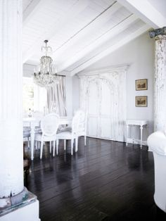 white walls, dark wood floors