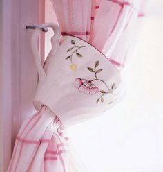 Use Chipped Teacups As Curtain Tiebacks - super cute for a kitchen with teacup pot lights overhead too.