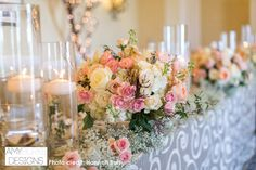 Close up of the low centerpieces and floating candles. Pink majolica, roses, and jasmine. #romantic Location Ritz Carlton Half Moon Bay
