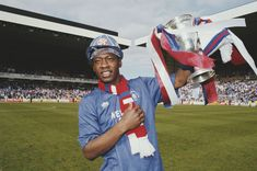 English professional footballer Mark Walters, midfielder with Rangers FC, celebrates with the trophy on the pitch after Rangers beat Aberdeen at Ibrox Stadium in Glasgow to win the Get premium, high resolution news photos at Getty Images Rangers Football, Rangers Fc, Glasgow, Liverpool, My Photos, Aberdeen, Pitch, Celebrities, Celebrity