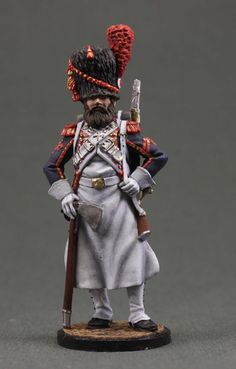 Toy tin soldiers 54 mm.Napoleonic War soldiers.Sapper Foot grenadiers of the Imperial Guard. France, 1808-12.