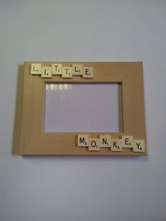 Scrabble Photo frame. different words but i love the idea for a christmas present