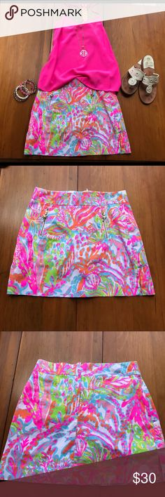 "LILLY PULITZER SCUBA TO CUBA MARIGOLD SKORT This super fun, bright summer print skort has side slits, and novelty front zippers with palm tree pulls. Back has 7"" inset zipper w/ button closure. Excellent condition. Lilly Pulitzer Shorts Skorts"