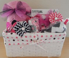 Lovely ladybug baby girl gift basket! Awesome baby items inside a nice basket with lining. It's the type of baby gift basket that makes a statement. This girl baby gift is not just sweet (cupcakes) bu