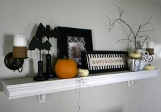 Halloween themed decorations, time fit me to get our mantle decorated.