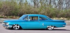 1960 Chevy Biscayne. We had one like this. Ours wasn't this low, but it had column shifter. This car was so monstrous! Look at those wings!