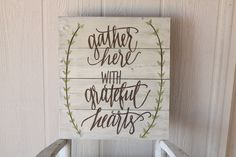 This hand painted wooden sign features a white washed background with brown font and green leaf detail. The phrase Gather Here with Grateful Hearts I think captures the beauty of this time of year, as Thanksgiving approaches and we enjoy the change in weather. Looking for something new for your fall mantle? This sign is a great size for that. Measures 16 x 14.    Ready to ship.