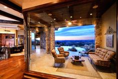 Entire walls of glass open to the panoramic view of the Texas Hill Country by Zbranek & Holt Custom Homes, Austin & Lake Travis Luxury Home Builders.
