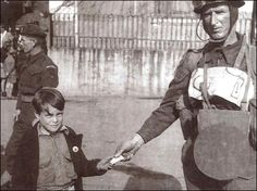 Liberation Day, May 9th, 1945.  Ayoung boy in St. Peter Port receives a chocolate bar from a British soldier.