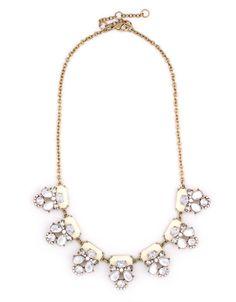 A dazzling white statement piece, featuring crystal stones.  This necklace is perfect for everyday, from work to the weekend.