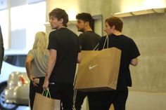Louis went shopping at Niketown in LA with Lottie, Tommy and Oli. April 12, 2016