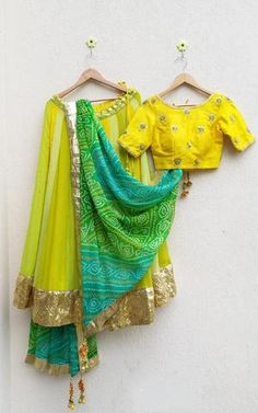 Comes with traditional bandhej Dupatta in green turquoise and yellow, with golden lappa border and Gota Tassels Half Saree Designs, Choli Designs, Lehenga Designs, Saree Blouse Designs, Indian Fashion Dresses, Dress Indian Style, Indian Designer Outfits, Indian Designers, Indian Wedding Outfits