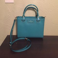 """NWT Kate spade purse NWT Kate spade purse, the color is Wellesley. Great bag has a zipper pouch in the middle which allows you to separate your items on either side. It is approximately 8"""" tall 10"""" long and 4.5"""" wide. Has a long strap to make it a cross body. No trades. kate spade Bags"""