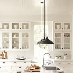 Rejuventation - tall glass kitchen cabinets