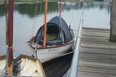 "Richard Dykes uses a Gelert ""rocky 2"" tent aboard his Drascombe Dabber w/ 5 planks for a sleeping platform"