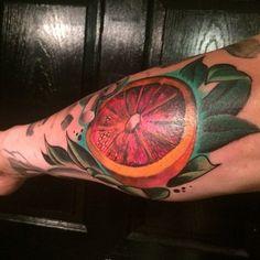 Delicious blood orange by Christopher Sabatino #InkedMagazine #fruit #bloodorange #tattoo #tattoos #inked #ink #art