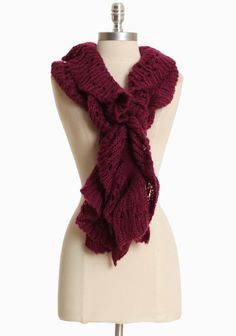 "Purple Majesty Ruffle Scarf 22.99 at This vibrant purple scarf is rendered in a soft knit with a hint of stretch and a delicately ruffled design.  100% Acrylic, Imported, 51"" length"
