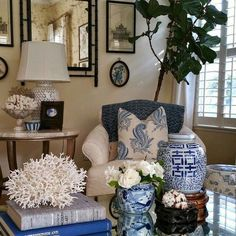 Credit: Paige minier - wonderful blue and white living room with blue and white Chinoiserie porcelains and coral