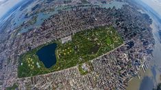 New York City's Central Park, initially opened in is seen here from feet in the air. The 843 acre park is the focal point of the shot but because of the fish eye lens we can see the entire island of Manhattan. Central Park Manhattan, Central Park Nyc, Manhattan New York, Rockefeller Center, Park In New York, New York City, Famous Landmarks, Aerial Photography, Park Photography