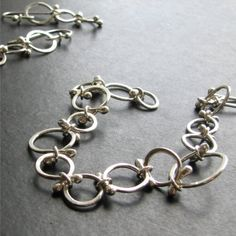Persie Bracelet: Sterling Silver Handcrafted by curlygirlglass. Note, I think I'd do the links in fine silver, to get better balled ends, then solder sterling jump rings. Maybe.