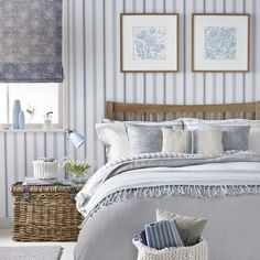Pale country blue striped bedroom with wooden bed with oversized headboard, wicker bedside table, patterned blind and framed pictures. Bedroom Color Schemes, Bedroom Colors, Bedroom Decor, Bedroom Ideas, Colour Schemes, Wallpaper Design For Bedroom, Wallpaper Ideas, Wallpaper Designs, Design Bedroom