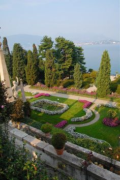 """Isola Bella"" across Lake Maggiore from Stressa, Italy.  (Borromeo Islands)  I took a similar pic from the balcony of the mansion on this ""Beautiful Island"", reached by ferry from Stresa, Italy. Lake Maggiore is also bordered by Switzerland."