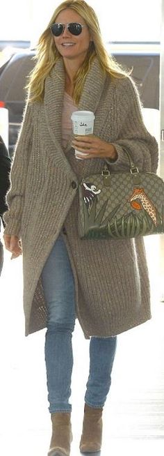 Who made Heidi Klum's tan cardigan sweater and jungle print handbag?
