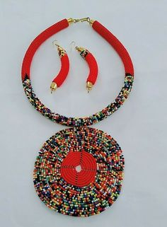 African Handmade round Maasai Beaded Necklace pendant, earrings set Red and other multicolored beads New. Handmade in Kenya, Africa. African Jewelry, Ethnic Jewelry, Pendant Earrings, Beaded Necklace, Rope Jewelry, Beading Ideas, Zulu, Native American Jewelry, Earring Set