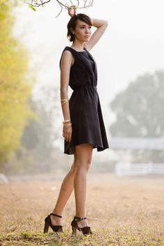 Be ready to shine in the deep-black Starry Night dress, which reveals its treasures one layer at a time.