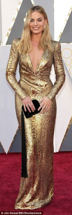 Glamorous: Made of a metallic sequinned fabric with a snakeskin-like texture, Margot's gown featured long-sleeves that fitted her slender arms perfectly