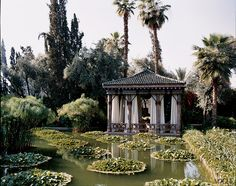 Marella Agnelli on Ain Kassimou grounds had architect Bill Willis create a pool pavilion in a wildness in Marrakech, gardens created by Madison Cox.