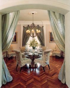 Like draperies on doorway,...round table.... ELEGANT DINING ROOM WITH HERRINGBONE FLOOR