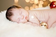 Newborn photo...like the fur and lights, can lose the ornaments and just make it look wintery and white