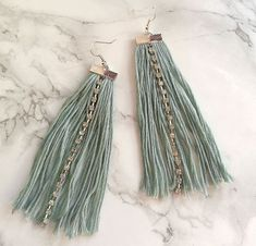 Dangling earrings serve so many purposes- distraction from a bad hair day, statement jewelry piece and make you look stellar. These DIY Diamante Fringe Tassel Earrings are beyond gorgeous.