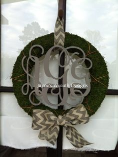 Moss wreaths with monogram letters in gray and chevron burlap ribbon