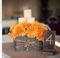 Centerpiece. Orange. Brown. Candles and Burlap