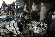 This kid is collecting Quran books after the Israeli zionest bombed the mosques in Gaza