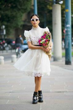 Take the cupcakeness out of a vintage-look white frock with a tough pair of motorcycle boots.