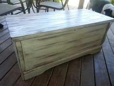 Distress an old hope chest by painting first with white primer; then after drying 24 hrs sand down to the wood where you want stain to adhere; stain all over and wipe off as much or little as you prefer.  Finish with a poly!