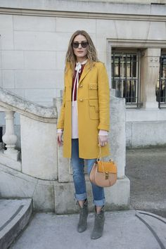 Outside the Chloé show, Olivia dressed for Spring in a bright coat, a shirt, and a bag, all by the brand, plus a cool pair of Westward Leaning sunglasses. Source: Getty / Kirstin Sinclair