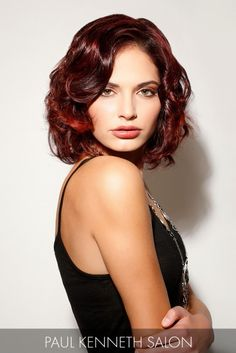 The trend factor of this wavy bob gets kicked up a notch with blends of mahogany and bright red pops of color.