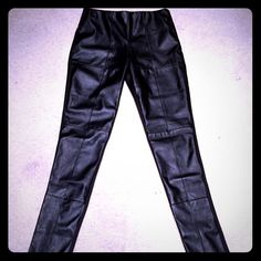 Faux Leather Front w/Material Back Pants/Leggings. Really Nice Faux Leather Front w/Material Back Pants/Leggings. These feel more like a pull on pant instead of a legging. Excellent quality. COS Pants Leggings