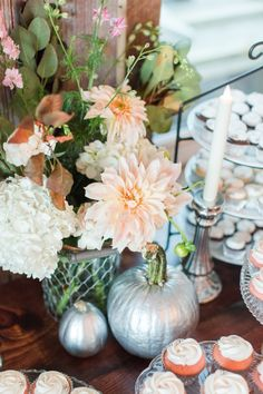 silver pumpkin and floral cake table decor