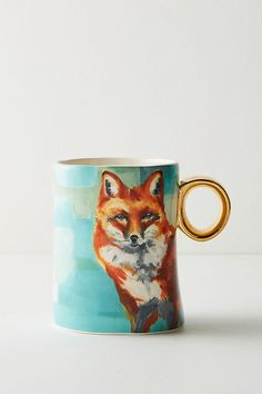 Winter Fauna coffee mug in teal blue or turquoise by Lauren Carlson Walcott for Anthropologie featuring a sly fox. #Anthropologie #fox #coffeemugs #laurencarlsonwalcott