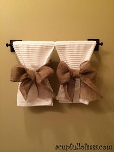 White towels with burlap ribbon. Cute way to decorate a bathroom.